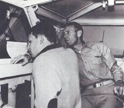 Picture of Admiral George S. Morrison and his son, James, on the USS Bon Homme Richard in 1964. Admiral Morrison oversaw the false flag operation of the 2nd Gulf of Tonkin incident. James Morrison is more widely know as Jim Morrison of the Doors.