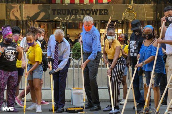 Al Sharpton and Bill de Blasio painting Black Lives Matter in front of Trump Towers