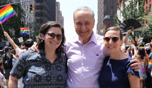 NY Senator, Chuck Schumer embraces his daughter and her fiancée at the NYC Pride Parade.