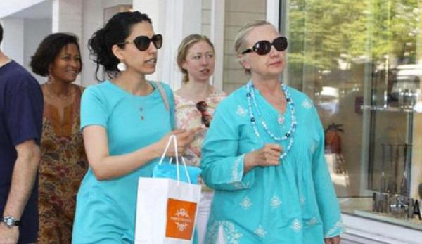 "Huma Abedin, pictured to the left of Hillary, is known as Clinton's ""shadow."""