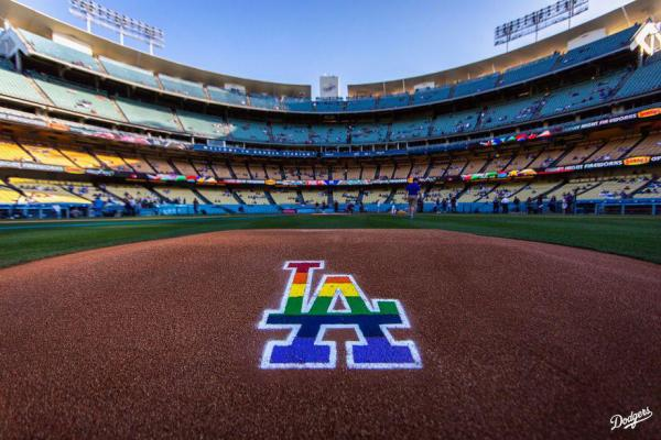 "The Dodgers wet rainbow on their logo behind the pitcher's mound on Queer ""pride night"""