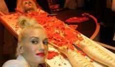 Gwen Stefani posing in front of the gory-looking red velvet dessert cake