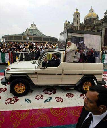 John Paul II riding in the pope mobile on the carpet of flowers in Mexico City, on July 31, 2002