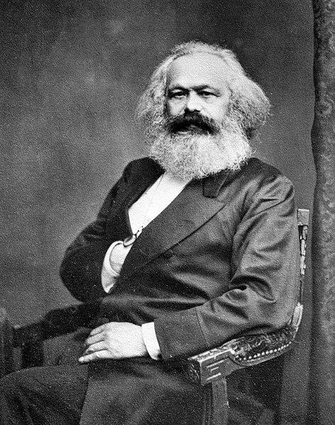 Karl Marx, descendant of a family of rabbis. Notice where his hand is a freemasonic sign.