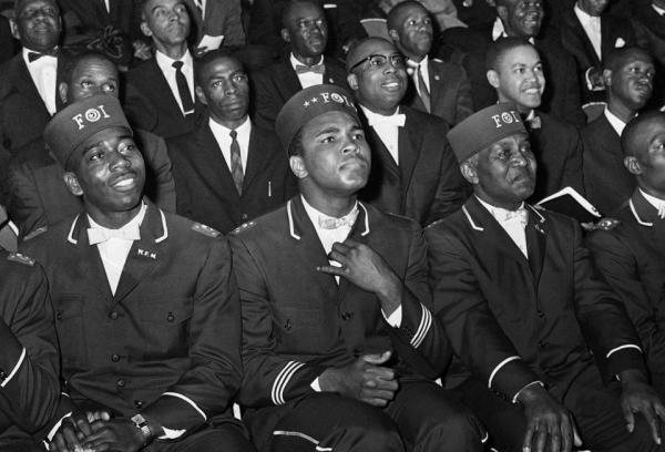 Muhammad Ali listened to Elijah Muhammad as he spoke to other black Muslims in Chicago on Feb. 28, 1966.