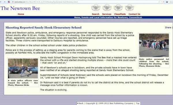 "A copy of the Newtown Bee which has the interview of the dead principal, Dawn Hochsprung and the fake picture in the upper right-hand corner.  Under the photograph it says, ""State police personnel led children from the school, following the shooting,--Bee Photo, Shannon Hicks."""