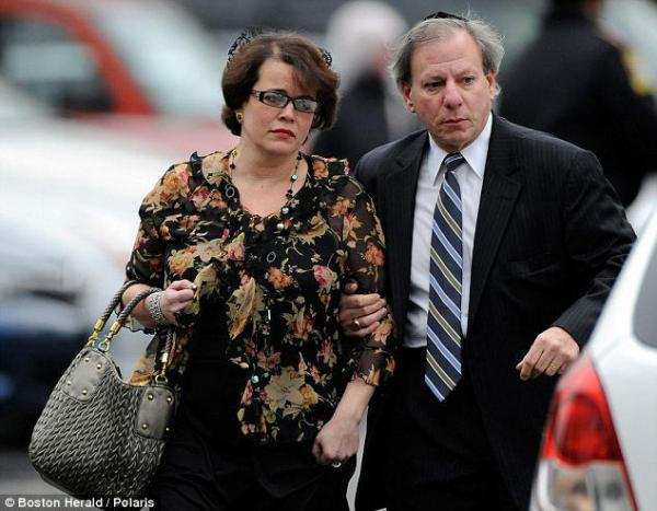 Noah Pozner's mother, Veronique, is seen leaving her son's funeral.
