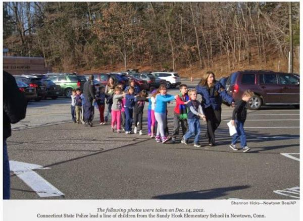 Connecticut Sate Police lead a line of children from Sandy Hook Elementary in 2012.