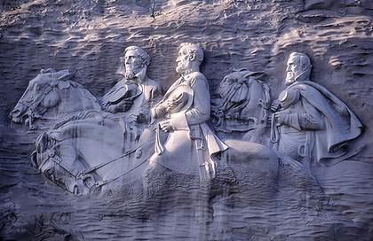 Three Confederate heros carved into the side of Stone Mountain, Georgia: President Jefferson Davis, General Robert E. Lee and General Stonewall Jackson.