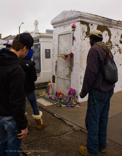 Tourists and locals visit Marie Laveau's tomb to leave gifts and ask for her help in their life matters.