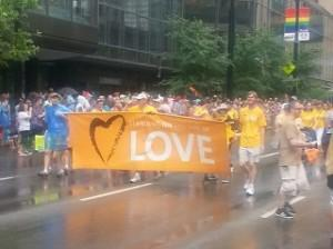 Members of liberal Universalist Unitarian march in the Cincinnati Pride parade.