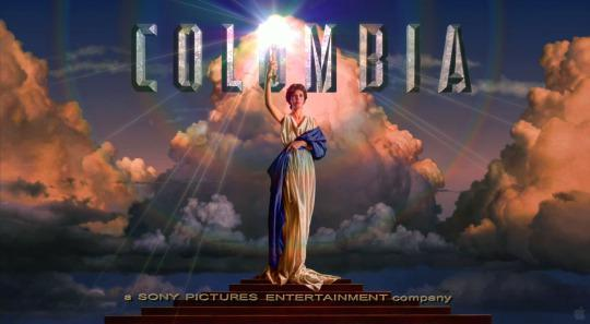 Columbia holding a torch as the symbol of Columbia Pictures.