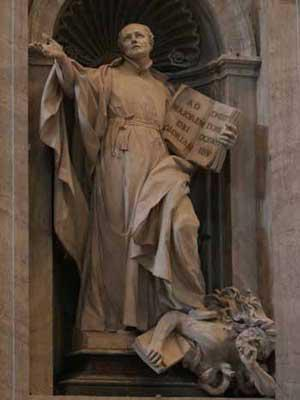 In this statue in the Vatican, Ignatius Loyola can be seen holding the Jesuit Constitution while he tramples underfoot a Christian with a Bible.