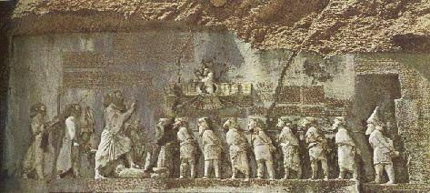 Bas-relief on the Behistun Rock where King Darius is facing nine captives, which are secured by the neck with a rope. A tenth is under the King's foot.